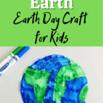 Top half of image has white and black text on bright green that reads: Coffee Filter Earth Earth Day Craft for Kids. Bottom half shows a flat round coffee filter colored with green and blue markers to look like the planet Earth. A green and blue washable marker is laying next to it.