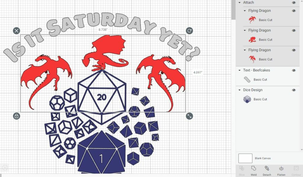 Screenshot within Cricut Design Space showing three dragon designs selected, color red, and attached. Dice sets design is in blue underneath the dragons. Above dragons curved text reads Is it Saturday yet? in gray.