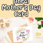 Black and white text on light yellow background reads Free Printable Floral Mother's Day Card. Below text is a preview of the floral Mother's Day card laying over an envelope. Flowers, gold pen, gold paper clips, sunglasses, and a small gift arranged around the card mockup.