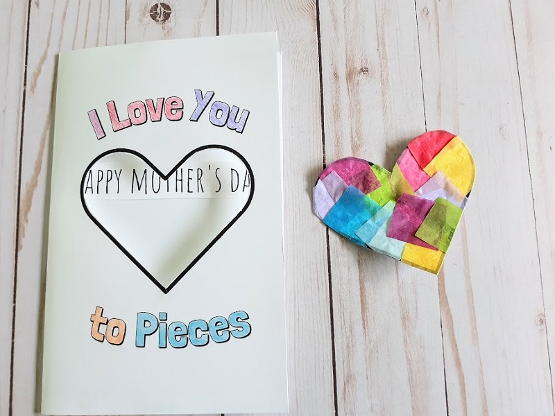 Overhead view of closed I Love You to Pieces card on table next to heart suncatcher.