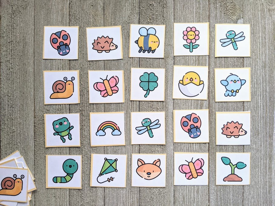 Spring themed matching cards cut out and laid out face up in 4x5 rectangle.