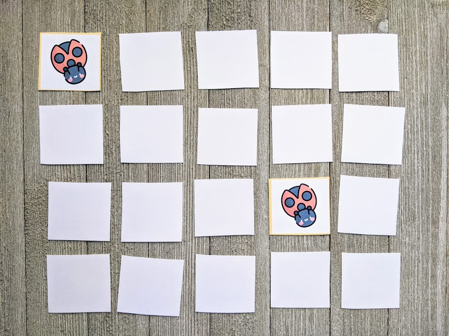 Spring memory match game cards laid out in 4x5 grid face down. Two cards with ladybugs are flipped over.