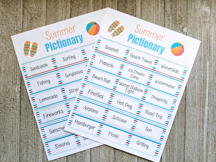 Two pages of summer pictionary game printed out and laying overlapping on a gray wooden table.