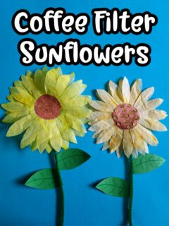 White text with black outline says Coffee Filter Sunflowers above two completed coffee filter sunflower crafts glued to blue construction paper with green pipe cleaner stems.