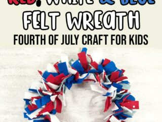 A picture of a felt wreath made with red, white, dark blue, and light blue felt strips hanging against an off white brick wall. Above wreath text in black, red, white, and blue says No Sew Red, White & Blue Felt Wreath Fourth of July Craft for Kids.