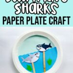White and black text on light blue background at top says Swimming Sharks Paper Plate Craft. Below text is a photo of a completed craft using a paper plate as a backdrop and decorated to look like the ocean and two paper shark puppets on popsicle craft sticks move around through slit in the plate.
