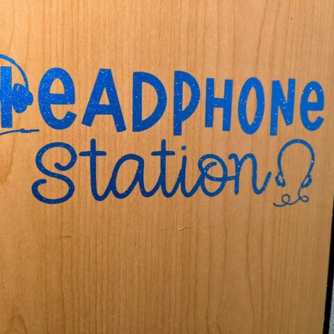 Blue glitter vinyl applied to side of wooden cabinet using the Headphone Station design from this project tutorial.