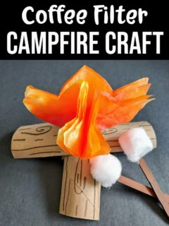 White text on black background says Coffee Filter Campfire Craft above picture of finished campfire made out of coffee filters and toilet paper tubes with cotton balls glued to brown craft sticks to look like roasting marshmallows.