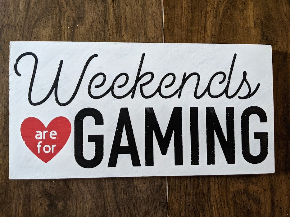 """Finished wooden sign project with black painted words Weekend and Gaming. Red painted heart with white words inside """"are and for"""" with white covering the rest of the sign. Weekends are for Gaming hand painted sign."""