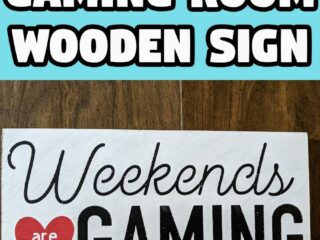 White text with black outline on bright cyan background reads DIY Gaming Room Wooden Sign. Below is picture of a wood sign painted white with black lettering and a red heart that says Weekends are for Gaming.